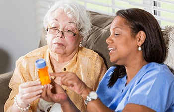 Skilled nurse checking resident's blood pressure at Maitland, FL