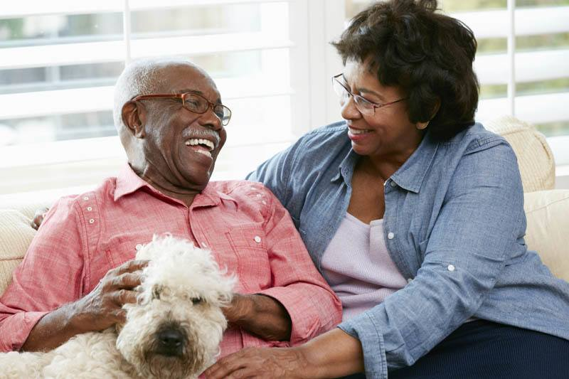 Happy family with dog at Senior Living Management