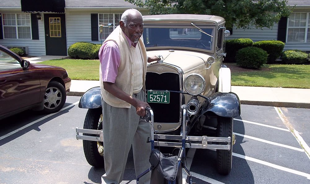 Man with an antique car in Bartow, FL