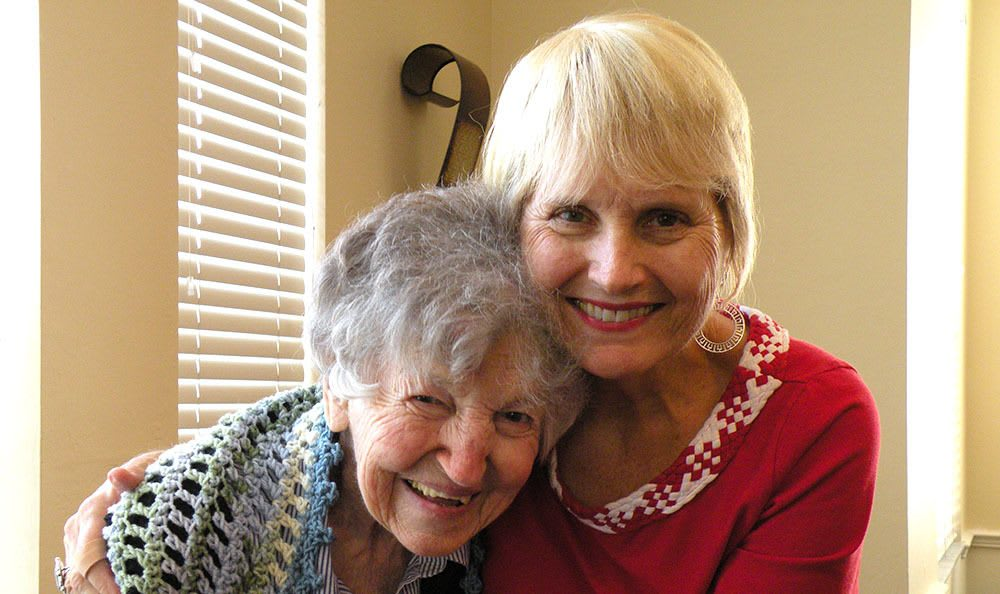 Happy resident with a friend at senior living in Brandon
