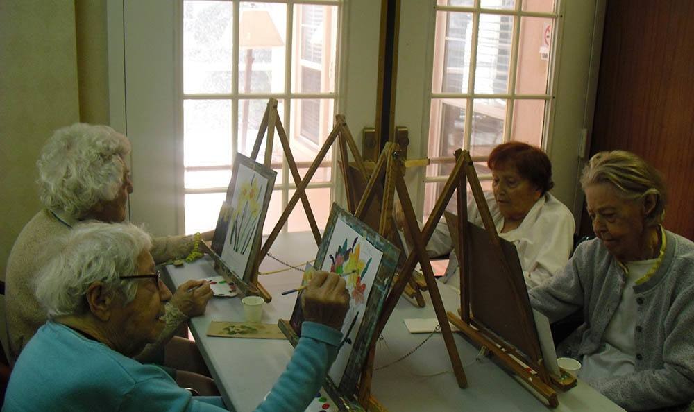 Group painting at senior living community in West Palm Beach, FL