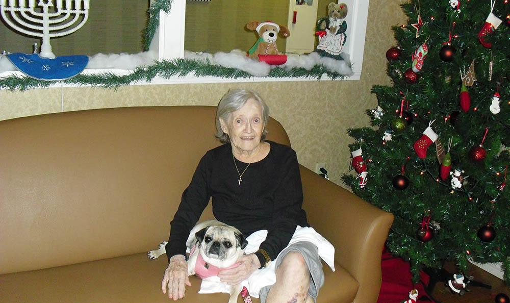 Woman with her pet at Savannah Court of the Palm Beaches