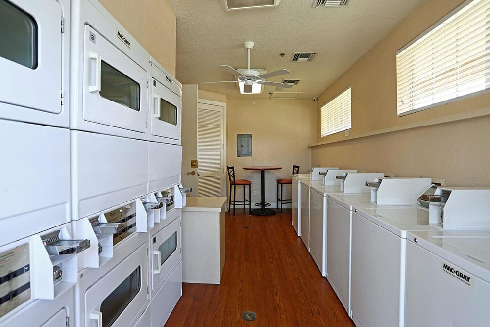 Community laundry area at The Grand Reserve at Lee Vista
