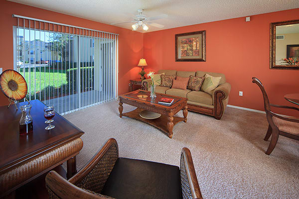 Apartment living room at The Grand Reserve at Maitland Park