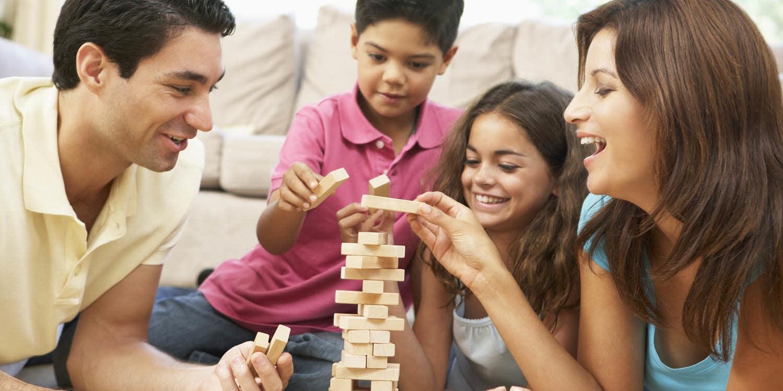 Family playing Jenga at Ancora Apartments in Orlando.