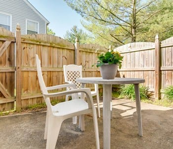 Outside Fenced In Table And Chairs