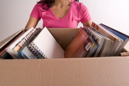 Woman taking handy packing tips from Storage World to pack her book