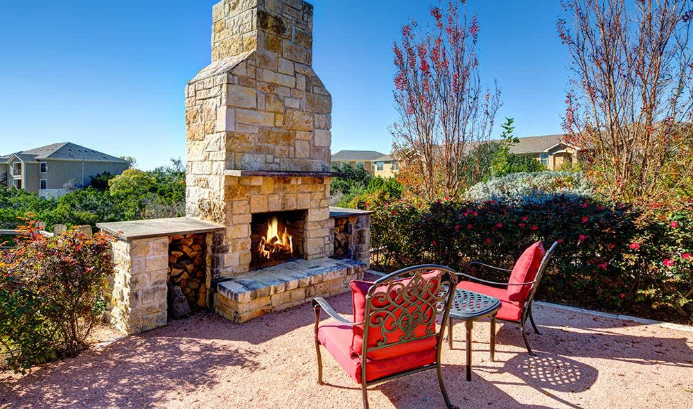 Outdoor fireplace at Marquis at Canyon Ridge, Austin