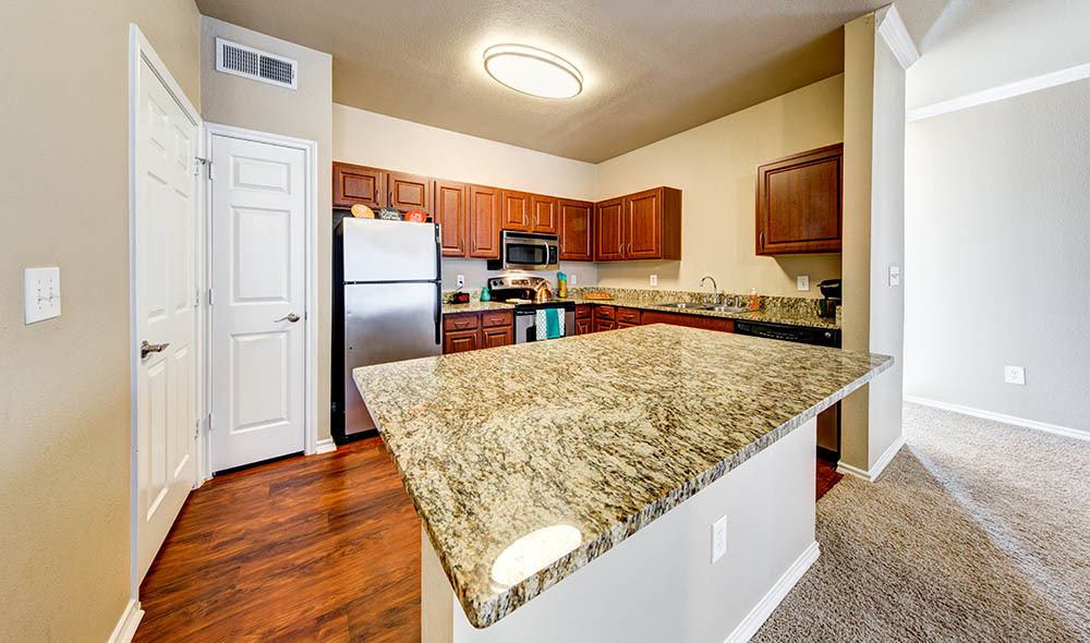 Granite countertop kitchen at Marquis at Bellaire Ranch, Fort Worth