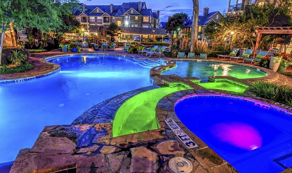 The pool stays open even at night at Marquis at Bellaire Ranch in Fort Worth, TX