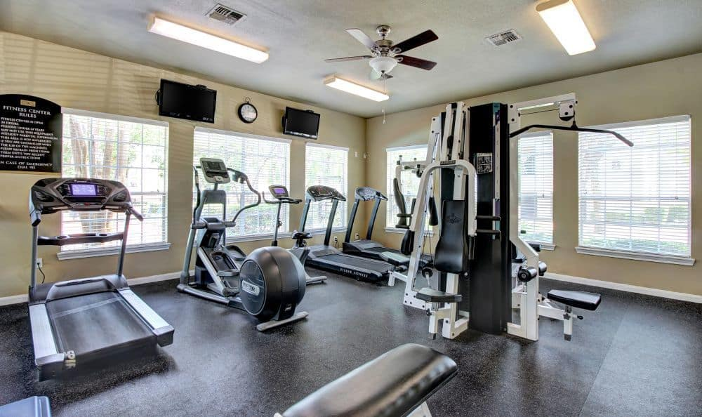 Fitness center at apartments Marquis at Westchase in Houston