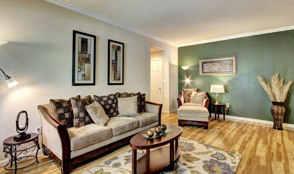 Well decorated living room at apartments Marquis at Westchase in Houston
