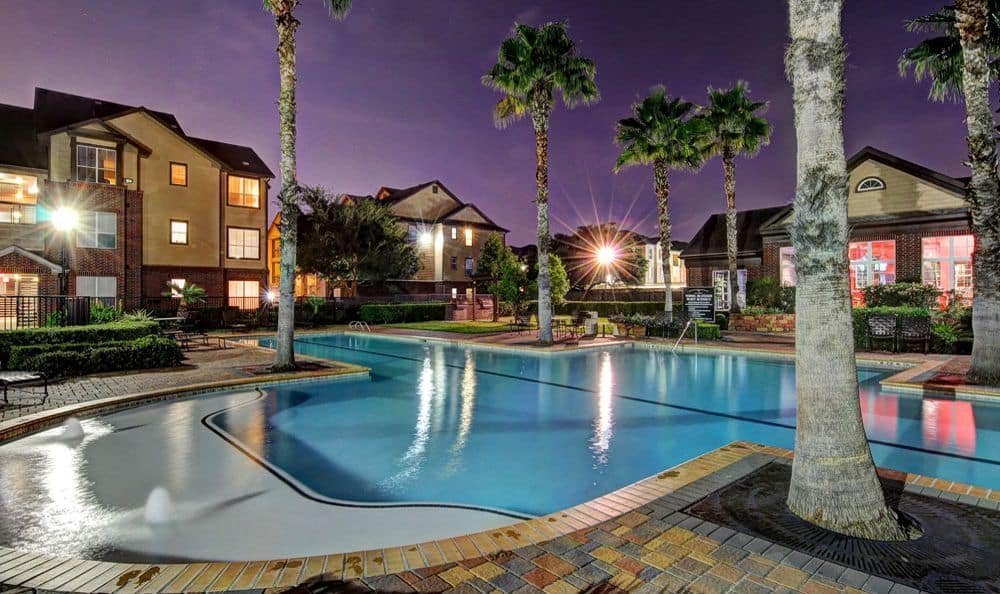 night shot swimming pool at apartments Marquis on Briar Forest in Houston