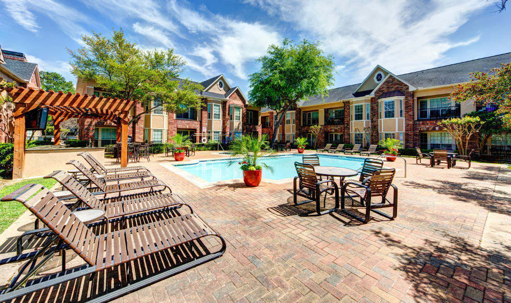 Get some sun on the sundeck by the pool at the apartments for rent in Houston, TX