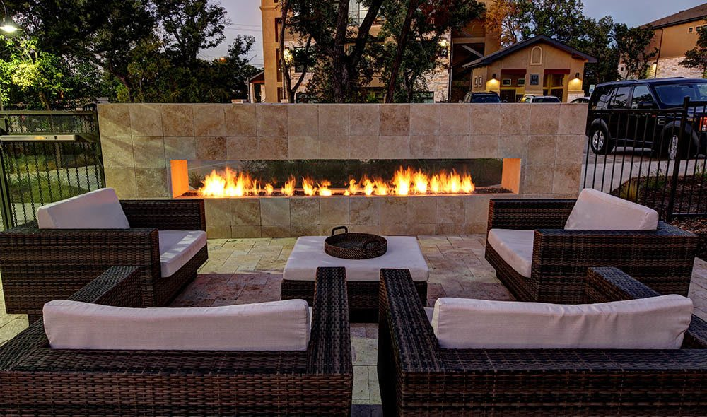 Enjoy an evening by the outdoor fireplace at The Marquis at Barton Trails