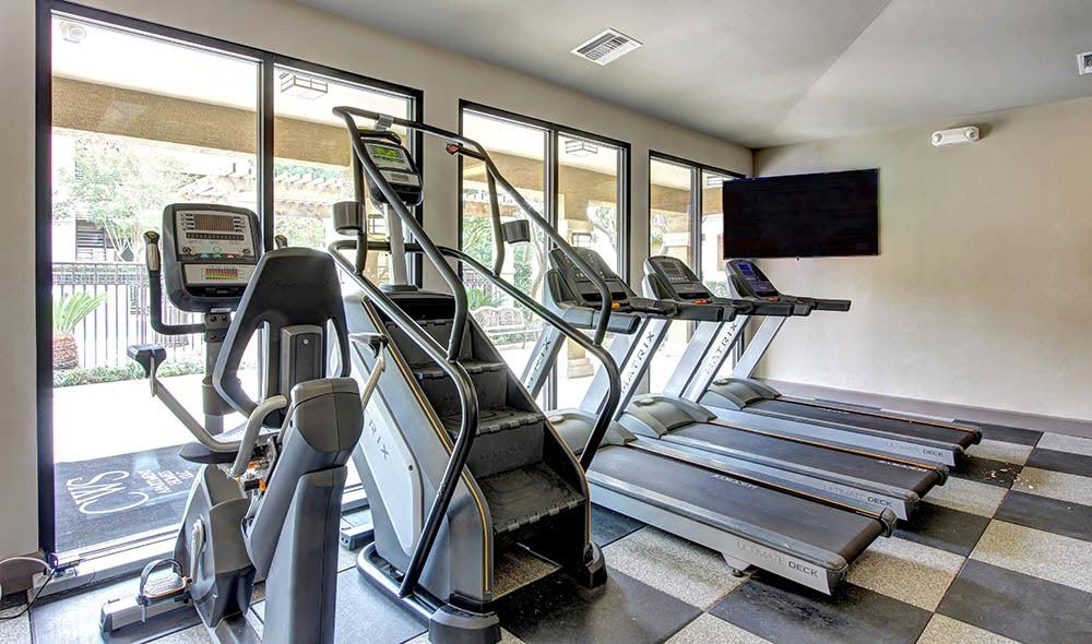 Fitness center with treadmills and climb master of The Marquis at Barton Trails