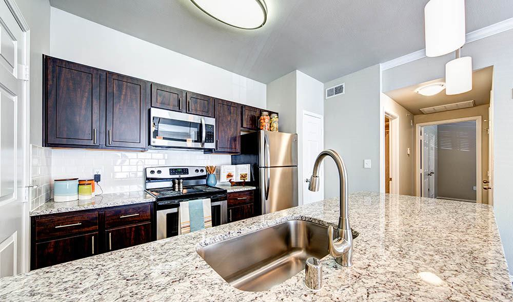 Upgraded kitchen with granite countertop at Marquis at Stonebriar in Frisco, TX