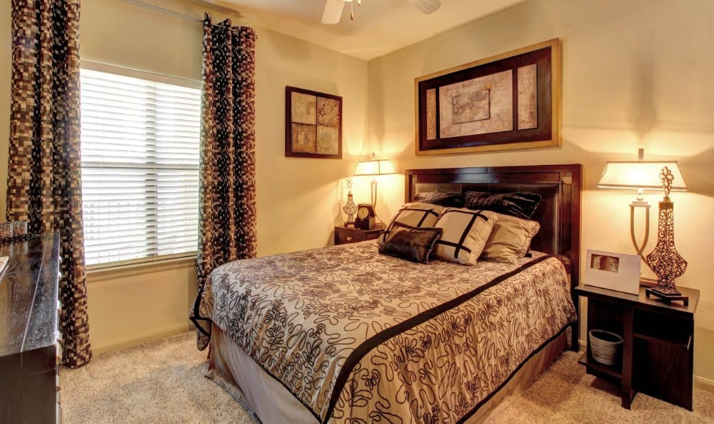Relax at night in your spacious bedroom at The Marquis at Katy in Katy, TX