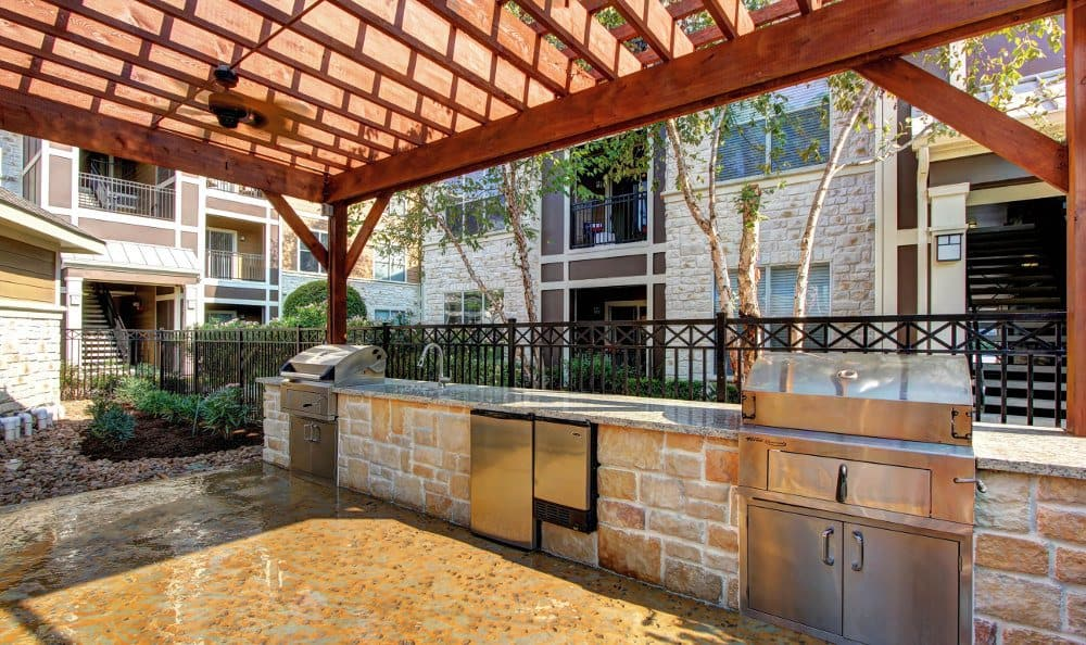 Exterior patio with the barbeque at Marquis at The Woodlands in Spring, Marquis at The Woodlands