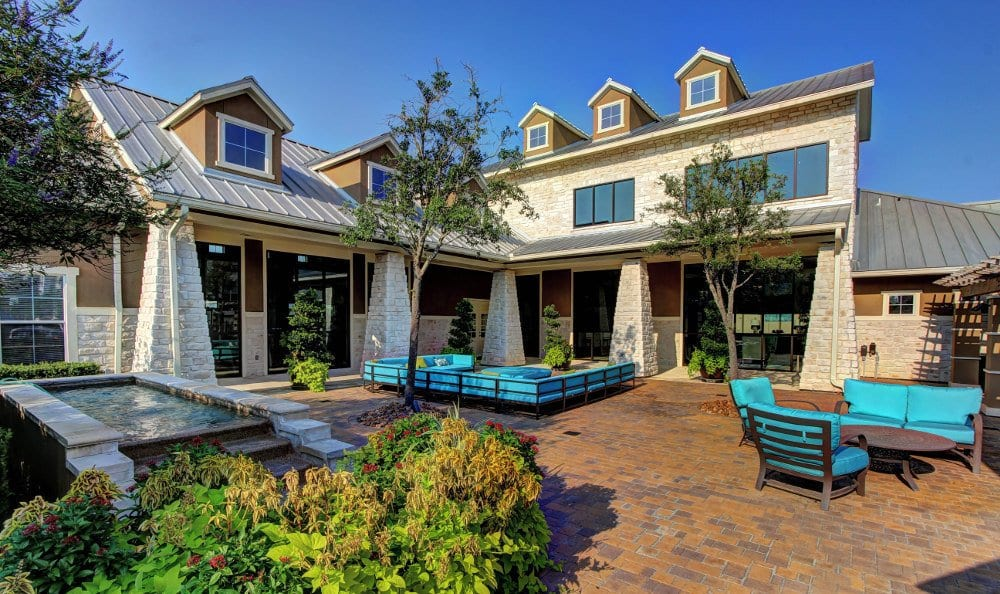 Relax in the clubhouse patio at Marquis at The Woodlands in Spring, Marquis at The Woodlands