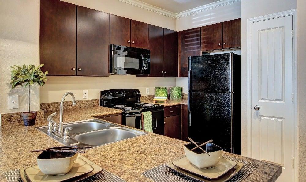 Enjoy the modern kitchen at Marquis at Sugar Land in Sugar Land, Marquis at Sugar Land