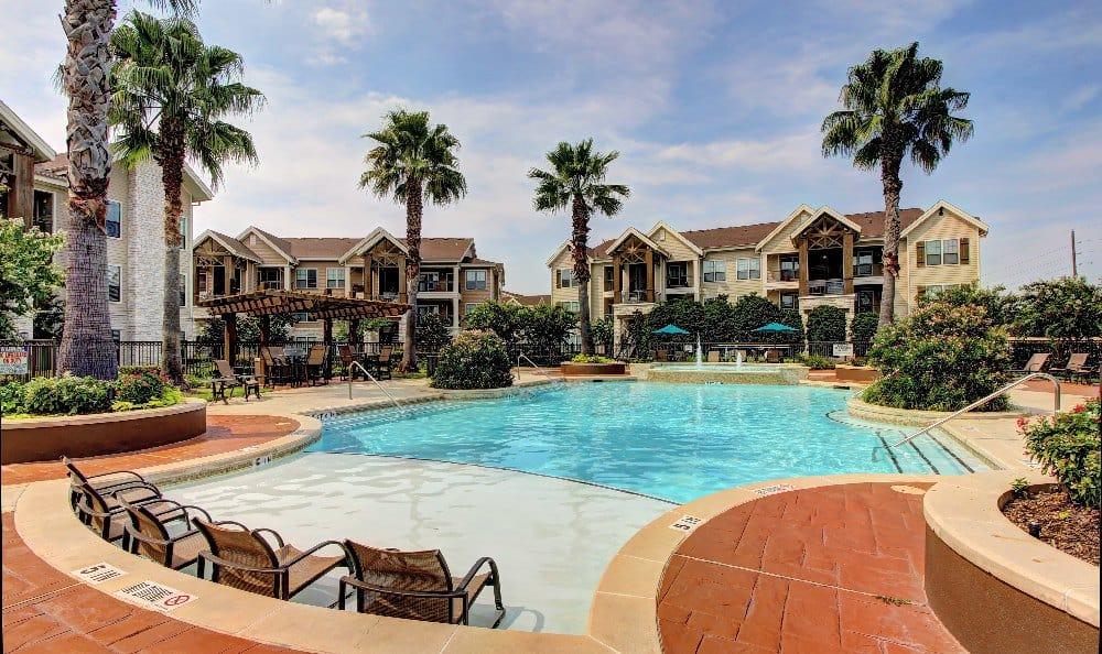 Relax at the swimming pool at Marquis at Sugar Land in Sugar Land, Marquis at Sugar Land