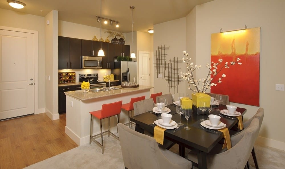 well decorated kitchen dining room combo at The Marq at Ridgegate in Lone Tree, CO