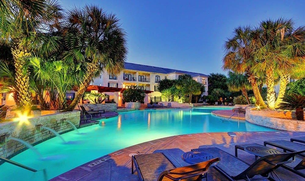 Beautiful pool at night at Marquis at Great Hills in Austin, TX
