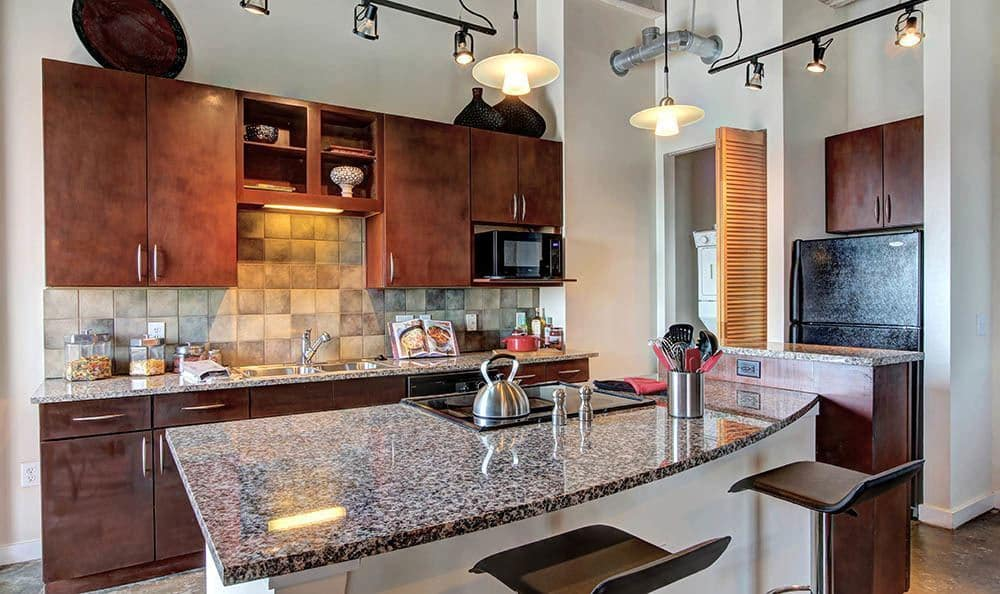 Lovely kitchen with granite countertops at The Marquis Lofts at Hermann Park in Houston, TX