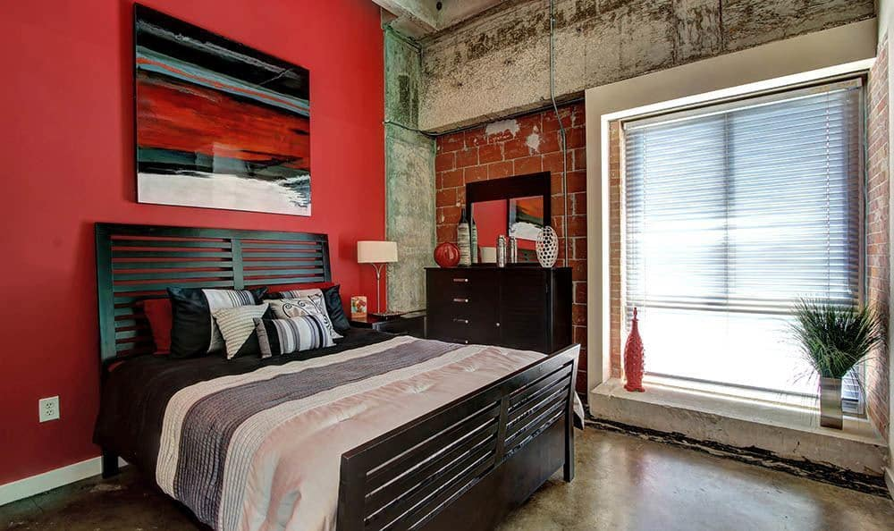Well decorated bedroom at The Marquis Lofts at Hermann Park in Houston, TX