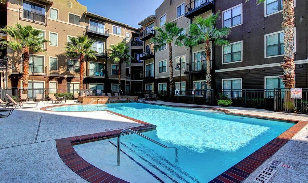 Resort-style swimming pool at The Marquis Lofts at Hermann Park in Houston, TX