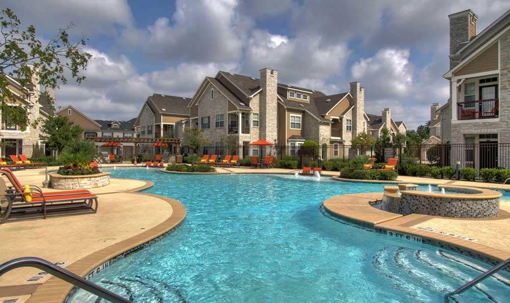 A sparkling pool is just one of the many amenities that Marquis at Cinco Ranch has to offer.