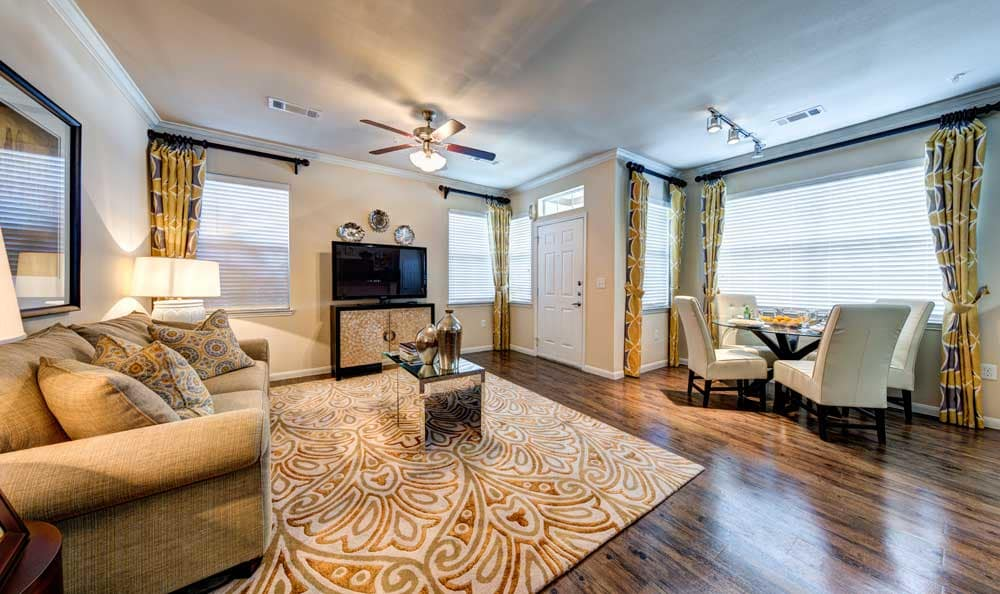 Spacious living room and dining area at Marquis at Cinco Ranch