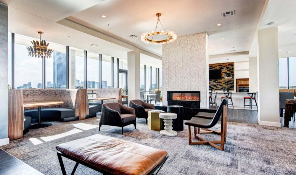 Seating and a cozy fireplace at Marq 31 in Houston, TX