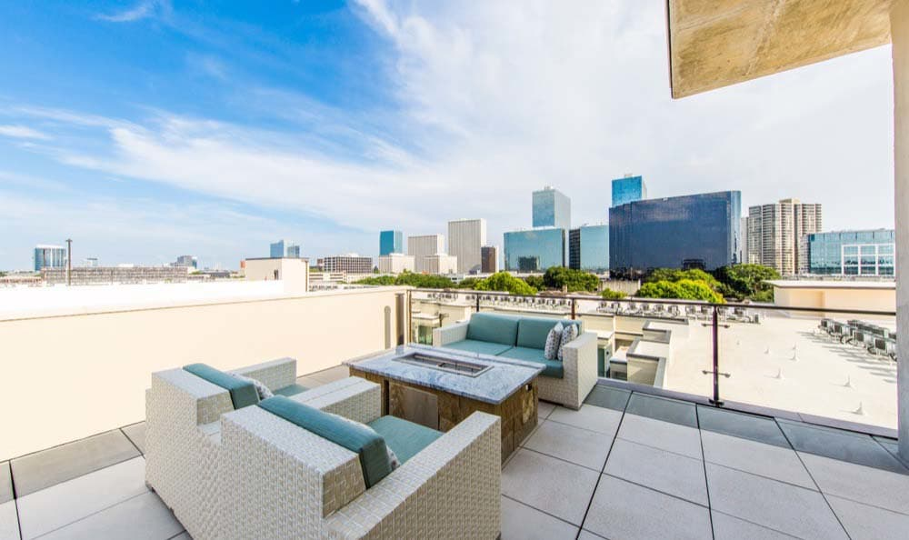 Outdoor seating and a fireplace at Marq 31 in Houston, TX