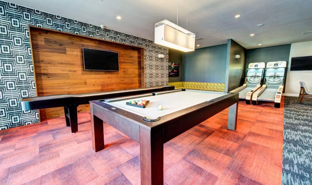 A billiards table is onsite for your enjoyment at Marq 31