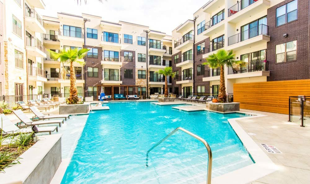 A sparkling pool is just one of the many amenities that Marq 31 has to offer.