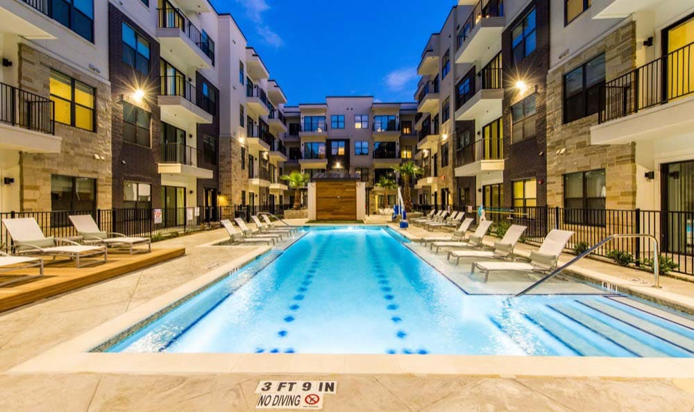 Pool in evening at apartments in Houston
