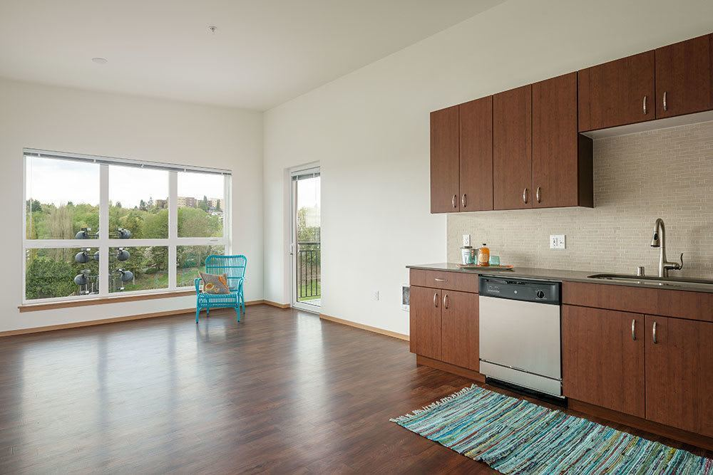 Open floor plans with an open kitchen at Marq West Seattle