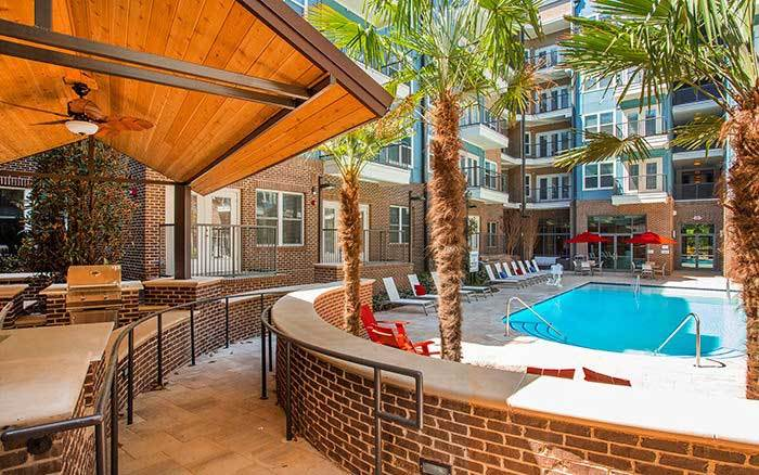 grilling area and swimming pool at Marq Midtown 205 in Charlotte, NC