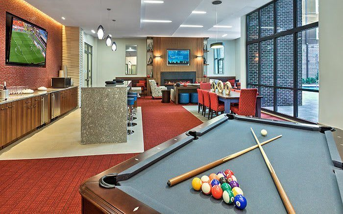 living room and billiard table at Marq Midtown 205 in Charlotte, NC