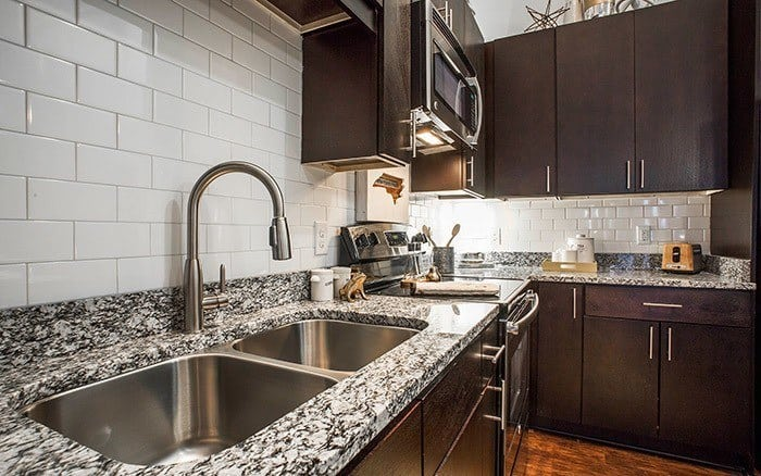 fully equipped kitchen at Marq Midtown 205 in Charlotte, NC