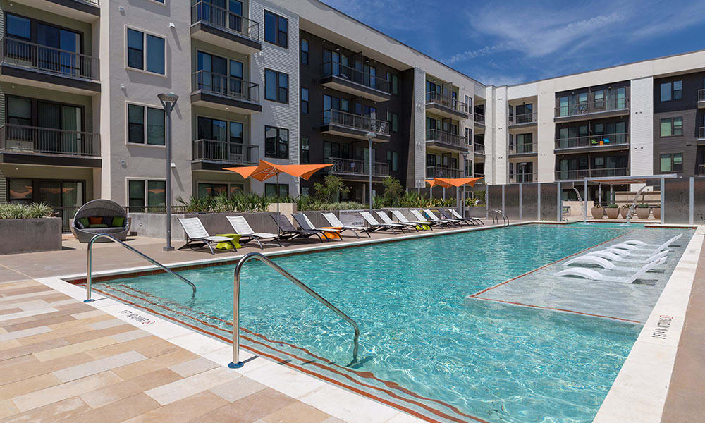 Resort-style swimming pool at Marq Uptown apartments for rent in Austin, TX
