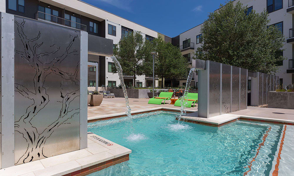 Resort-style pool with fountain in Austin, TX