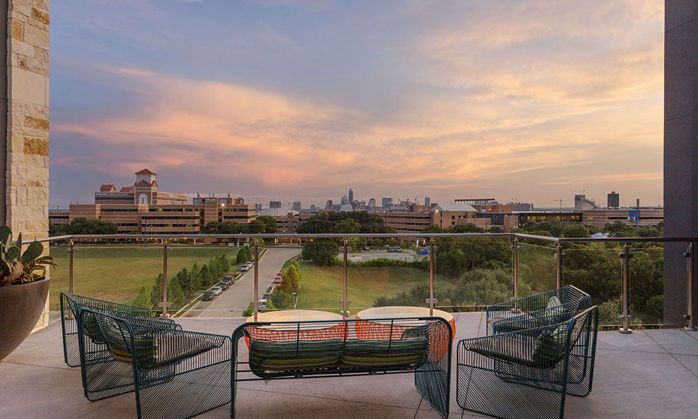 Sun deck at Marq Uptown looking over Austin, TX at sunset