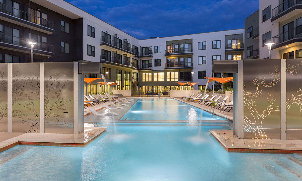 Marq Uptown's resort-style pool at night
