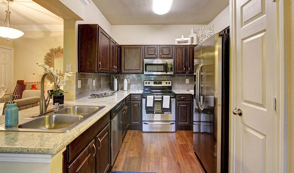 Upgraded kitchen including granite countertops at Marquis at Kingwood, Kingwood