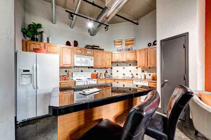 The kitchen is conveniently located at The Marquis Downtown Houston Lofts in Houston, TX