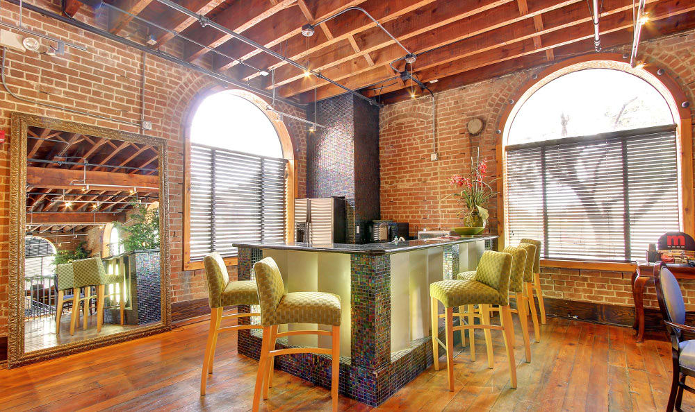 Enjoy bar seating in the kitchen at The Marquis Downtown Houston Lofts in Houston, TX