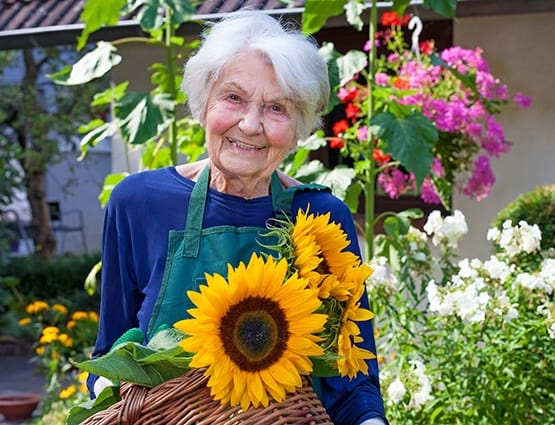 One of our AssistedSenior.com community residents gardening